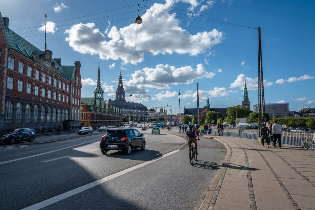 Sunny summer day in the street of Copenhagen. Christiansborg Palace on background.